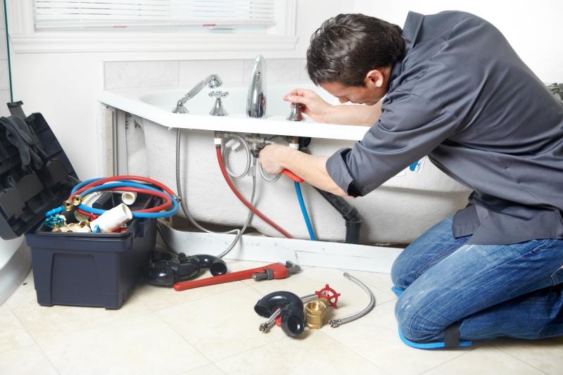 plumbers installing boilers